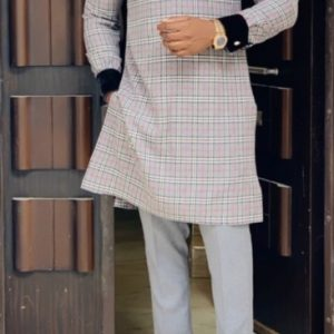 Collared, Burberry-like Patterned Shirt With Long Sleeve That Matches The Collar.