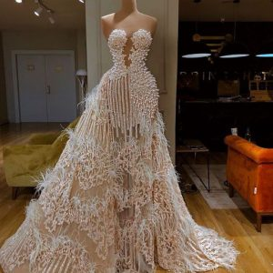 Expensive Bridal dresses made of lace, bridal satin and feather accessory.