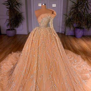 Bedazzled custom made Champagne Ballgown wedding dress