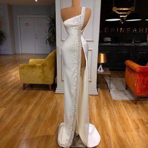 Elegant custom made beaded white satin dress with thigh-high slit