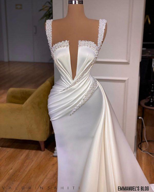 Sophisticated Custom made white beaded satin dress