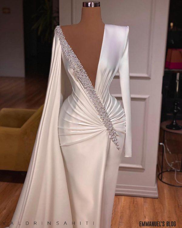 Stunning custom long sleeve white satin beaded dress